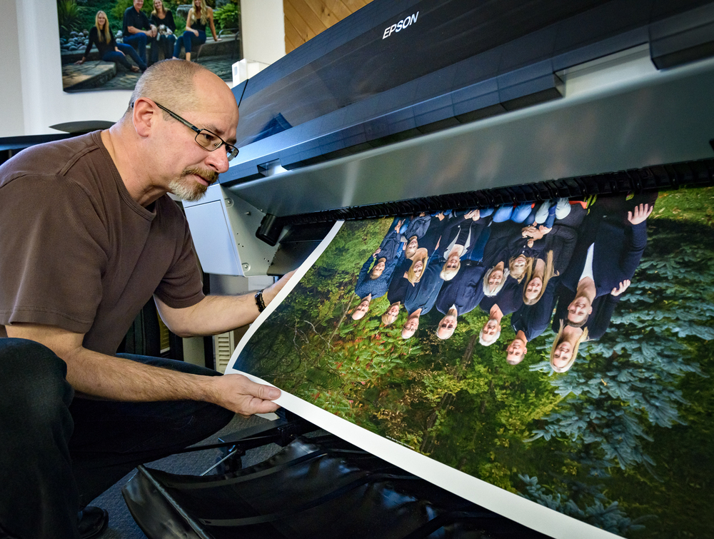 "Mike inspecting a portrait for accurate colour and tonality as it comes off the printer. This particular one is a 30"" portrait on archival certified canvas."