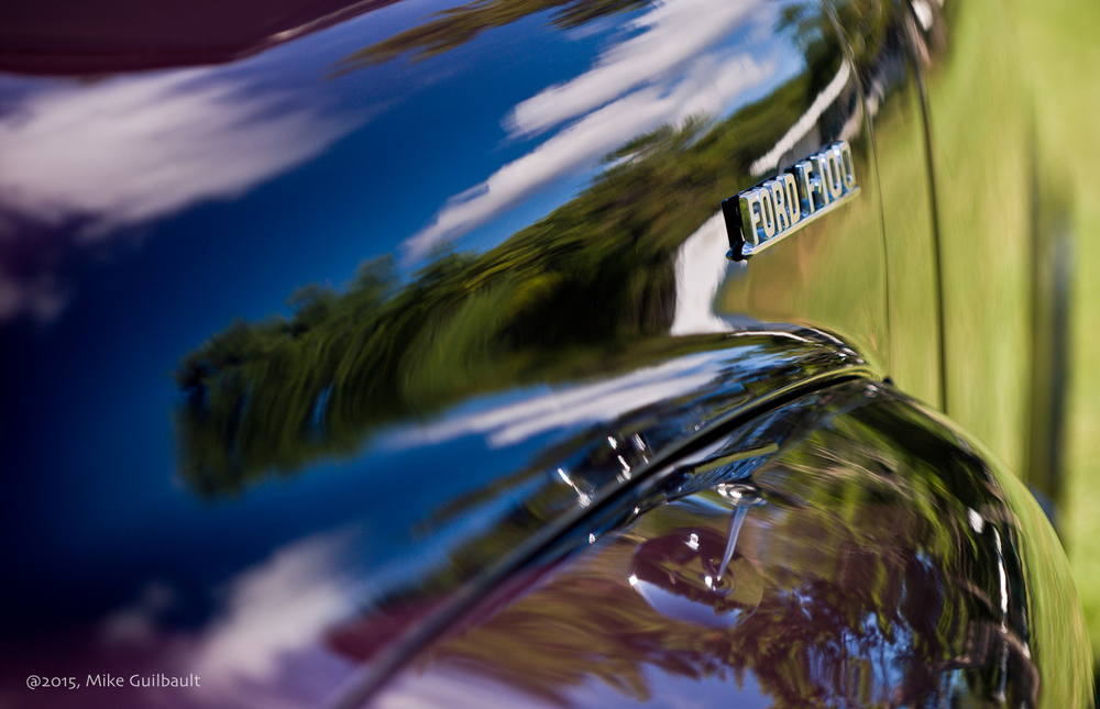Detail of hood and fender showing not only the beautiful lines of this Classic, but the incredible finish as well.