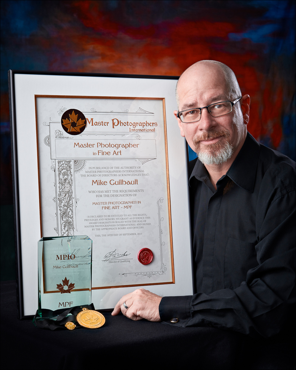Local Photographer, Mike Guilbault, with his recent Award and Designation.