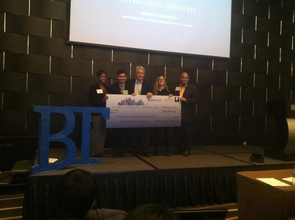 AsylumConnect co-founders, Sayid Abdullaev and Katie Sgarro, accepting the check for $15,000 with the 3 BT Impact Challenge judges.