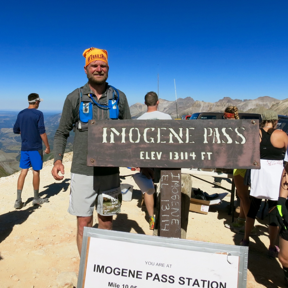 Colin rocking the TrailsRoc orange at Imogene Pass in 2015