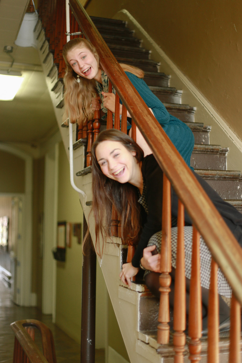 Such a good photo idea...until I realized that both of them are still taller than the banister when sitting down. Free the sopranos!
