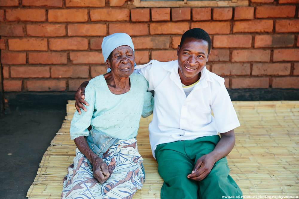 Grandmother and grandson in African village Malawi