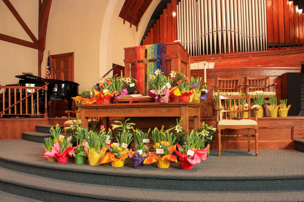 Lilys and Daffodils decorated the sanctuary