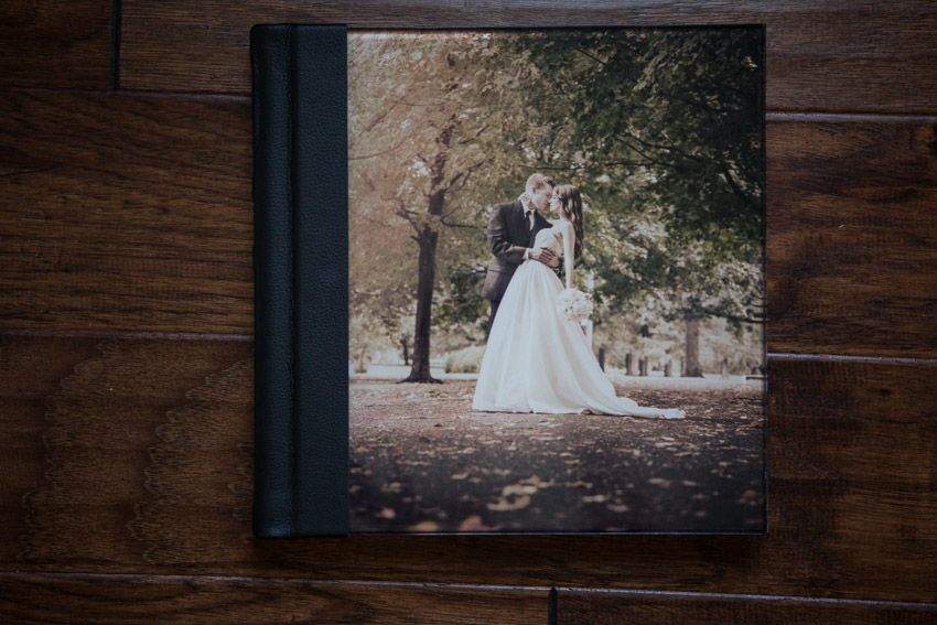 A clear acrylic front cover panel with a metallic print bonded to the underside. Sturdy, with beautifully finished beveled edges, it is scratch resistant and cleans easily. This elegant cover option is a favorite.