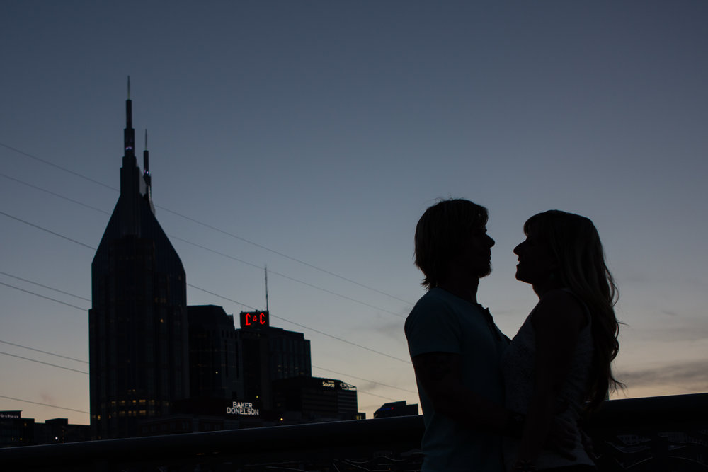 We finished up this beautiful and fun engagement session on the pedestrian bridge at Sunset.