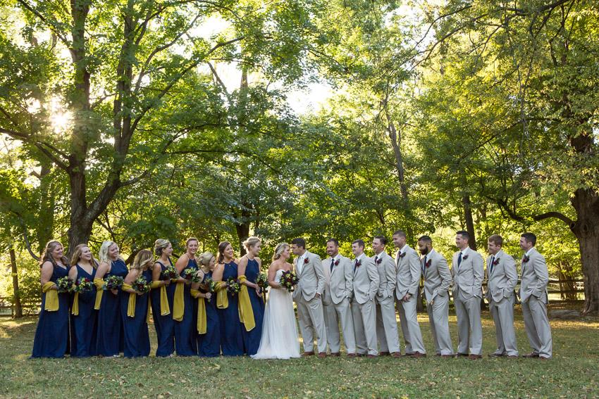 bridal party having fun at wedding portraits