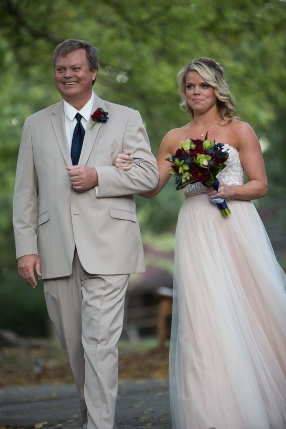 Father smiling as walking daughter to Nashville Wedding