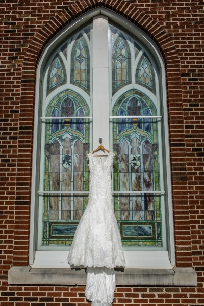 Her dress was just gorgeous and the stained glass was perfect.
