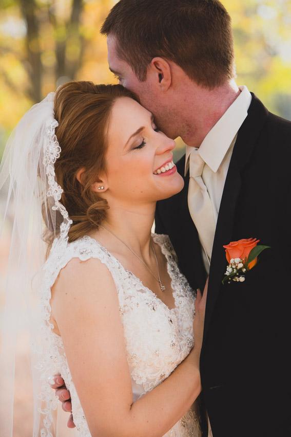 pensive moment captured  between bride and groom