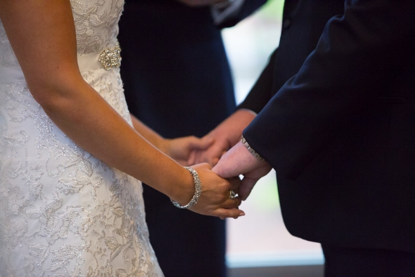 bride-and-groom-holding-hands-at-alter.jpg