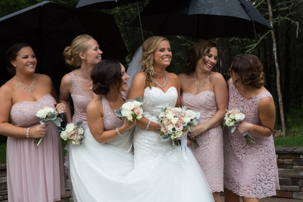 bride-bridesmaids-umbrellas-laughing.jpg