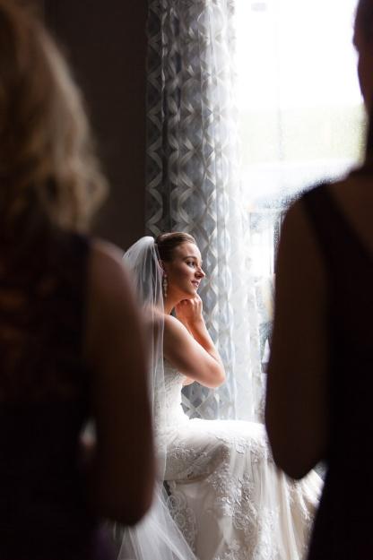 bride-putting-earrings-on-nashville-wedding.jpg