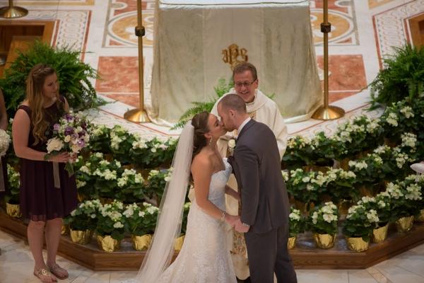 bride-and-groom-first-kiss-church-wedding.jpg