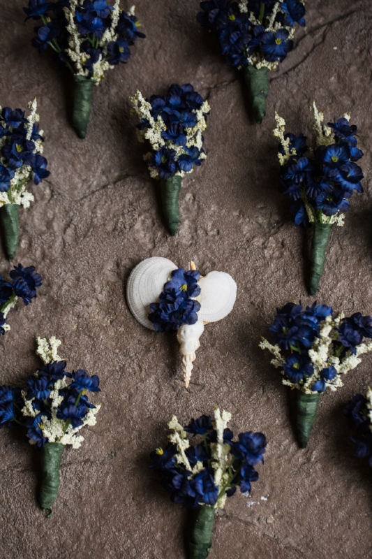 We love these unique boutonnieres.  The shells are perfect for a Bahama born groom.