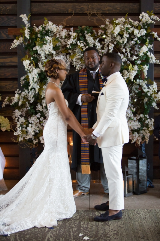Nelson-andrews-leadership-lodge-wedding-bride-and-groom-at-alter.jpg
