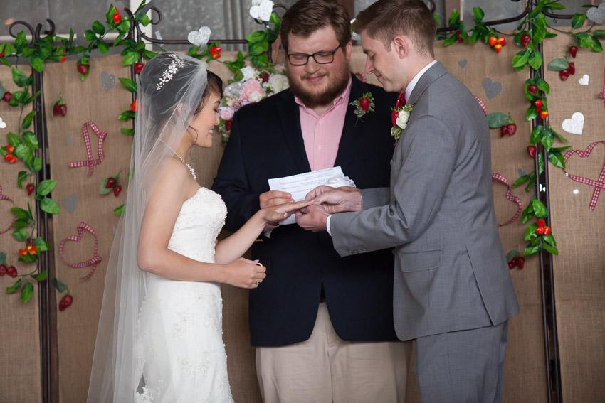 groom-putting-ring-on-brides-finger-nashville-wedding.jpg