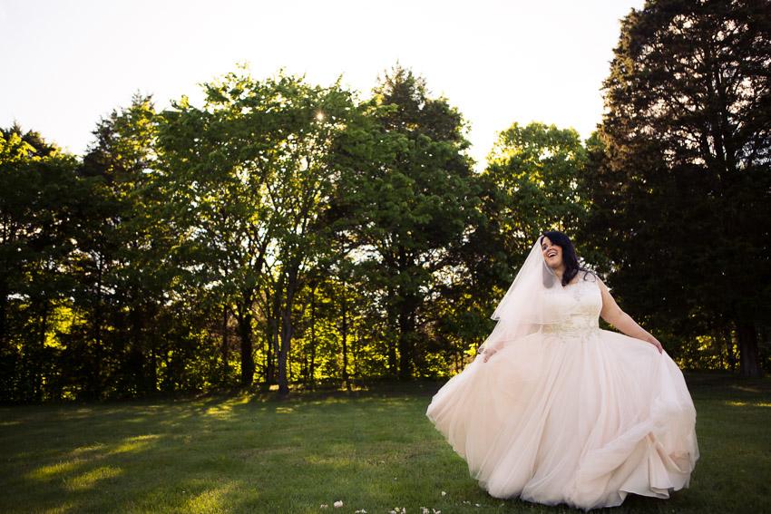 Bride twirling in stunning wedding dress