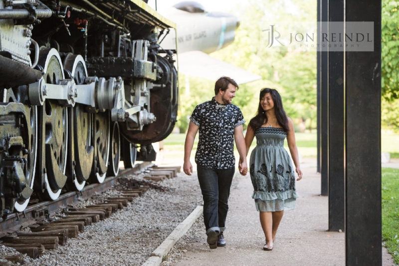 couple-walking-by-train-at-centennial-park-engagement-session.jpg