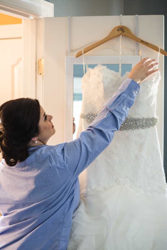 bride-reaching-for-wedding-dress-nashville.jpg