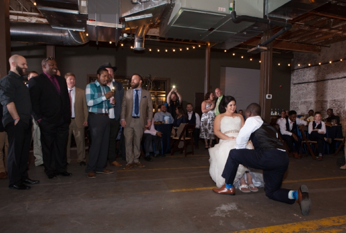 groom-taking-garter-off.jpg