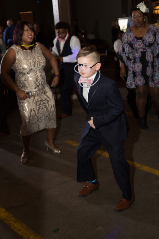 ring bearer wearing glow in the dark glassses