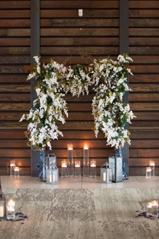 Flowers, lanterns and candles. That is a great combination for this beautiful wedding at Nelson Andrews Leadership Lodge in Nashville.