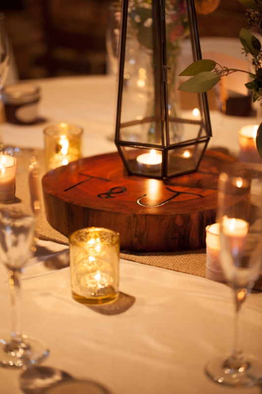 This table scape was perfect with the custom made wood blocks, combined with the candle cups and flowers.