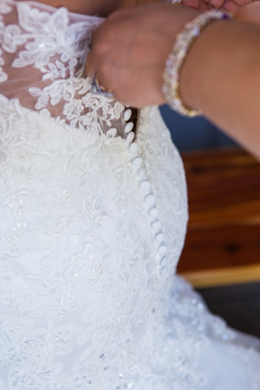 Helping to zip up bridal gown