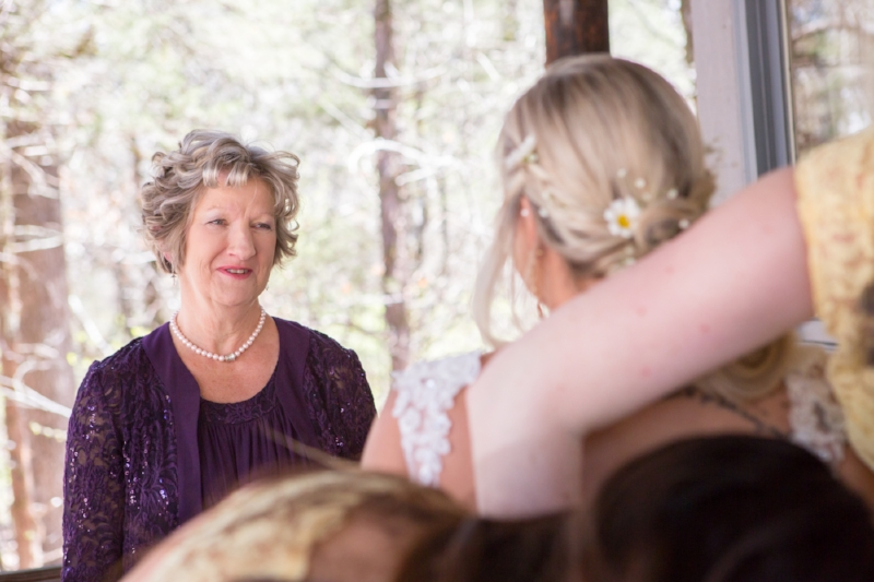 Shanna's mom seeing her for the first time in her wedding dress on wedding day. She arrived just in time to help with the final buttons on the dress. Always fitting that the hands that held the brides as a child are the ones to button the dress on her wedding day.