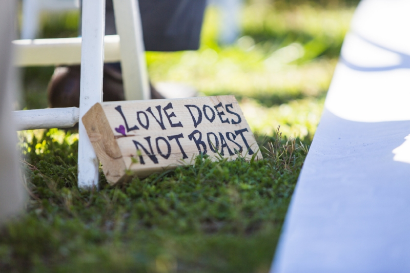 love does not boast sign