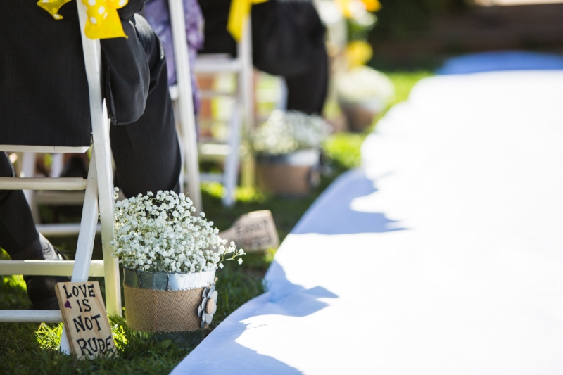 isle lined with babys breath and scripture signs