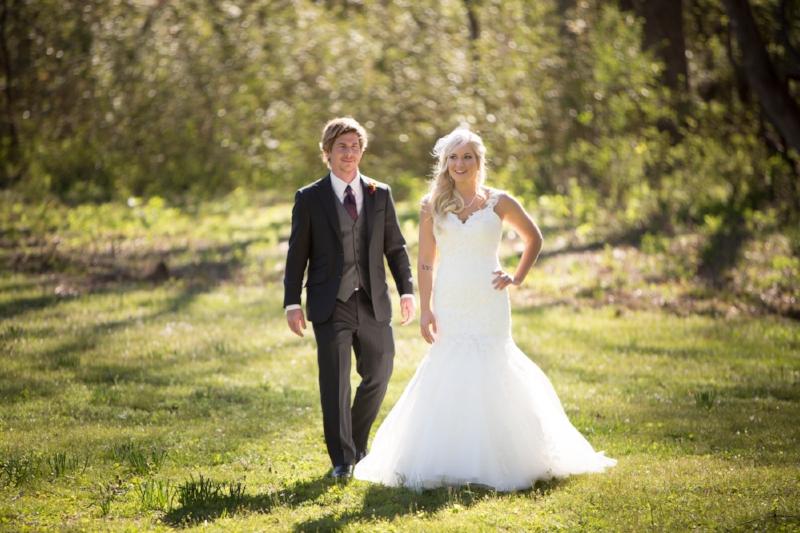 Bride walking up behind bride
