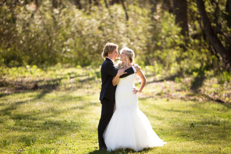 Groom hugging bride