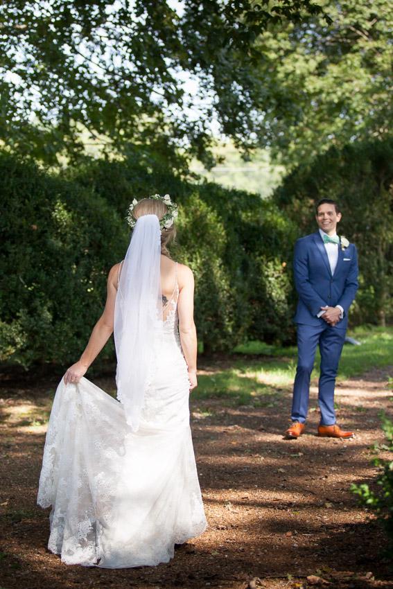 groom-seeing-bride-first-look.jpg