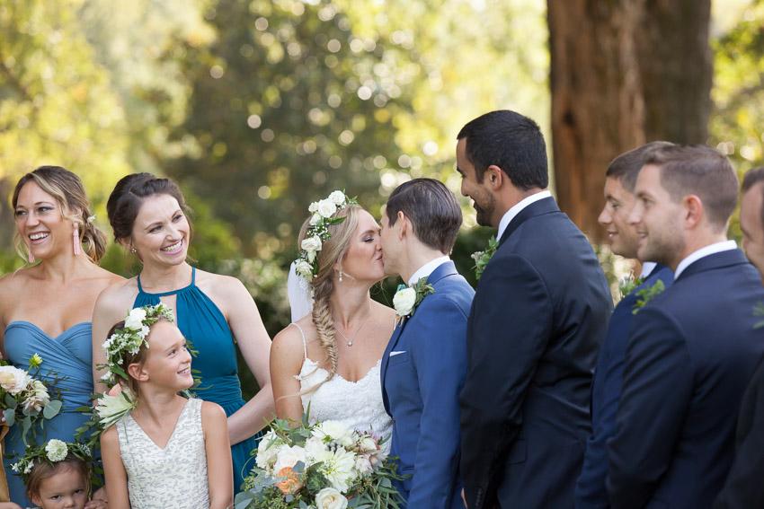 bridesmaid-smiling-at-couple.jpg