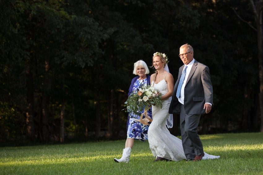 Bride entering with parents