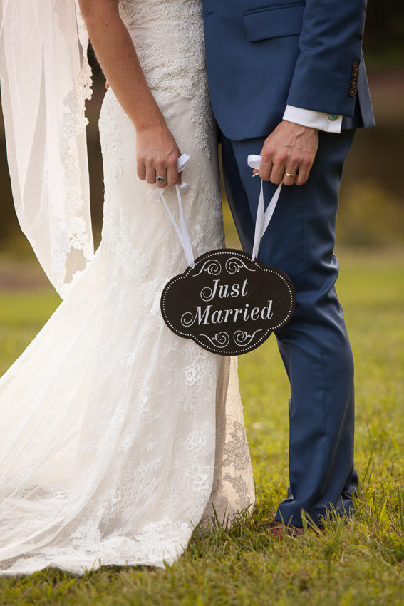 couple-holding-just-married-sign.jpg