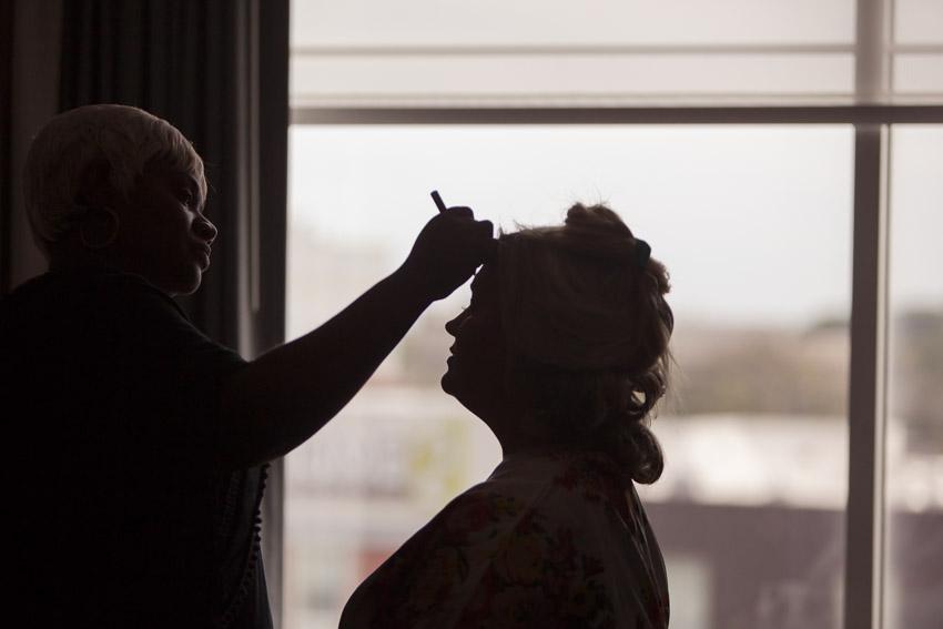 silhouette-bride-getting-makeup-on.jpg