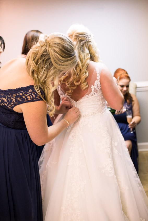 belle-meade-plantation-bride-putting-dress-on.jpg