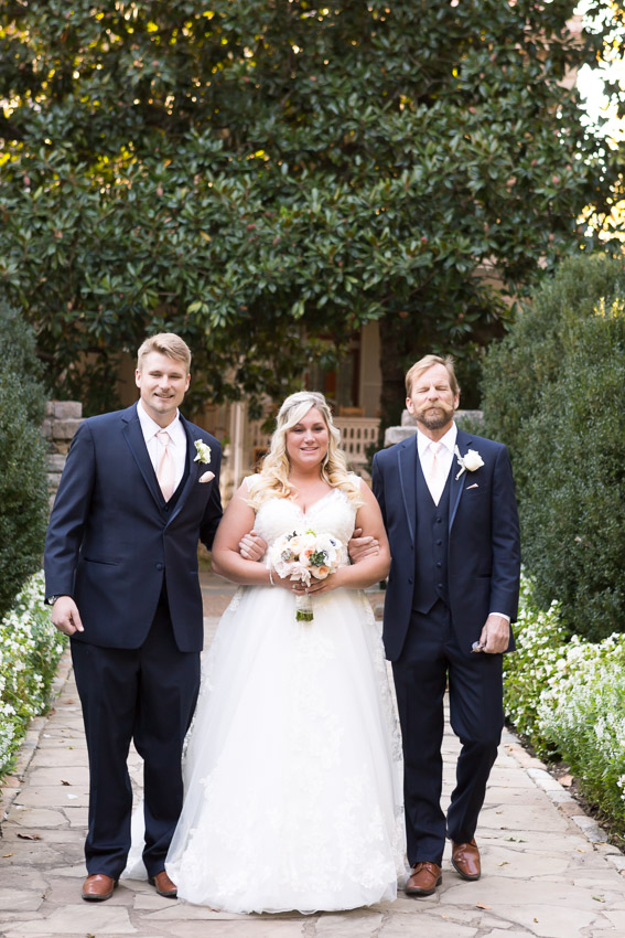 father-and-brother-walking-bride.jpg