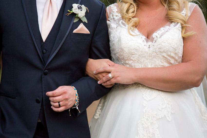 bride-and-groom-linked-arms.jpg