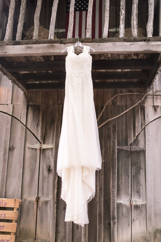wedding-dress-at-smiley-hollow-hanging-on-barn.jpg