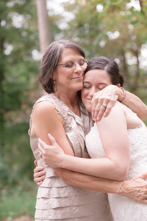 mother-hugging-daughter-at-smiley-hollow-wedding.jpg