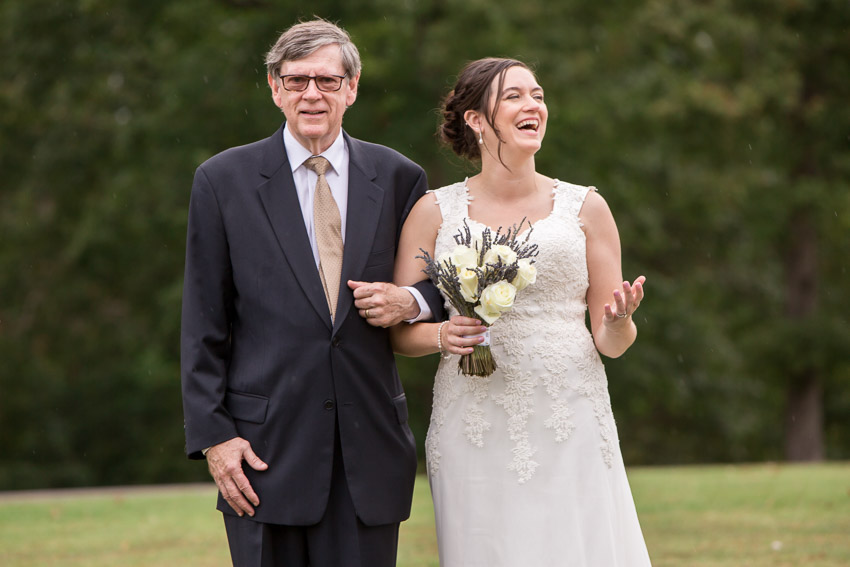 bride-laughing-at-rain-smiley-hollow-wedding-nashville.jpg