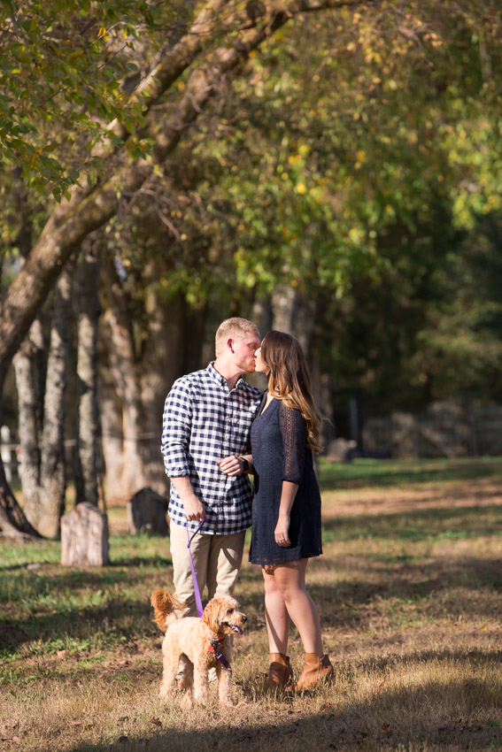 engaged-couple-kissing-at-legacy-farms-session.jpg