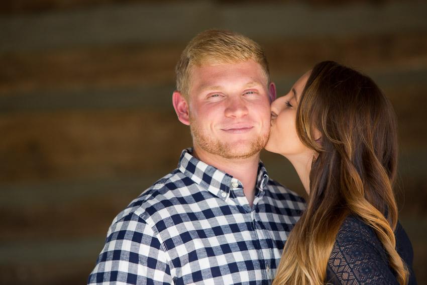 girl-kissing-guy-image-at-legacy-farms-photo-session.jpg