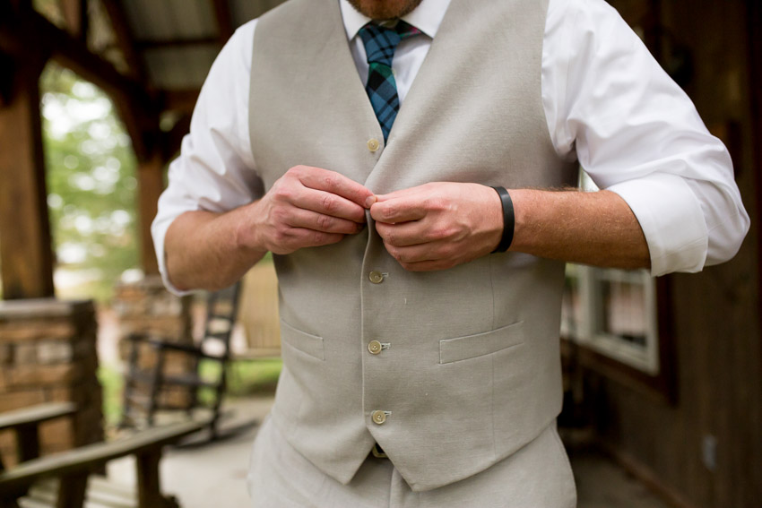 groom-putting-on-vest.jpg