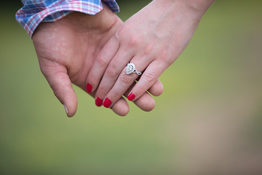 engaged-couple-holding-hands-engagement-ring.jpg