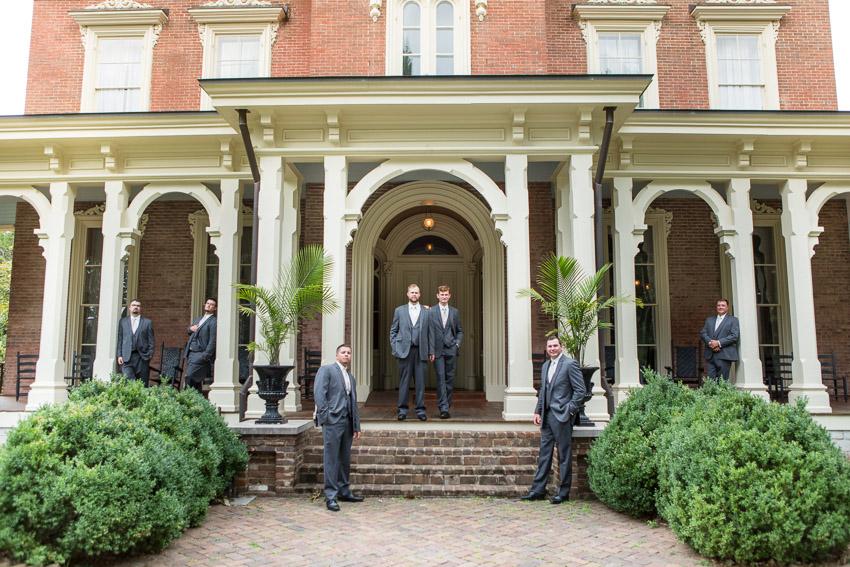 groom-on-steps-oaklands-mansion.jpg